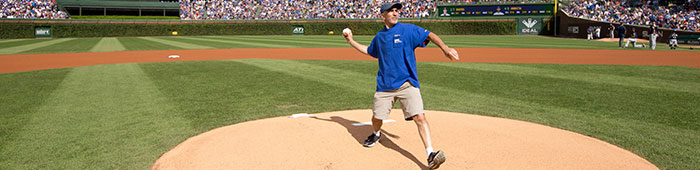 Artist Ron Styne throws first pitch at a Cubs game!